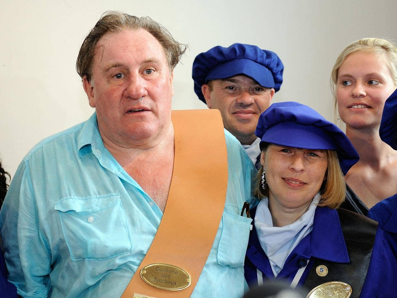 French actor Gerard Depardieu poses with people from Estaimpuis during a ceremony held in his honor at  the Chateau Bourgogne